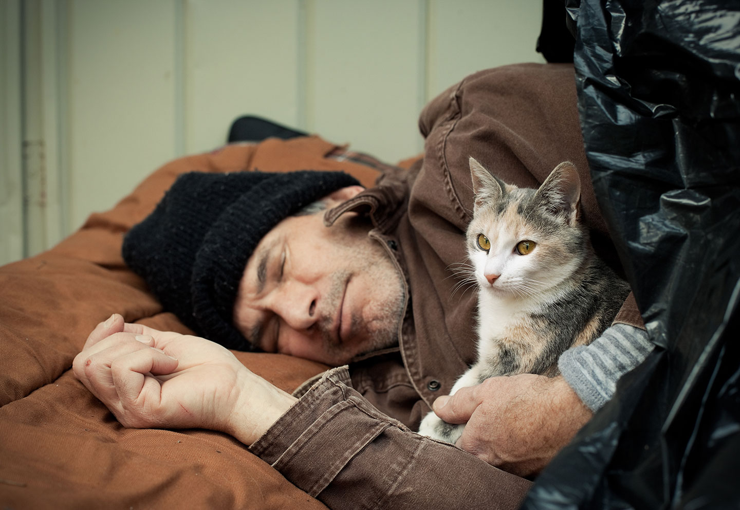 homeless person with cat