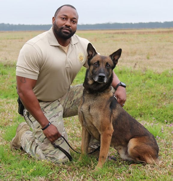 Sgt. Quinton Jones with his partner, K9 Officer Jake. Jake joined the department as a small puppy in 2014